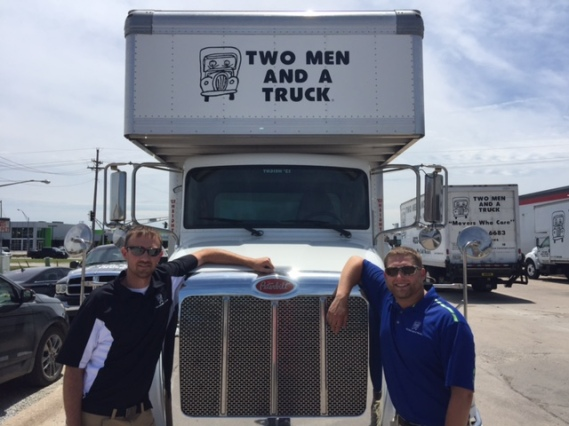 Tyler and Justin front of truck